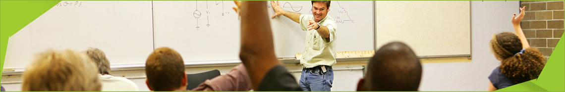 a teacher taking questions from his students
