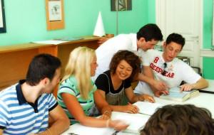 A french language tutor working with his students in Montpellier