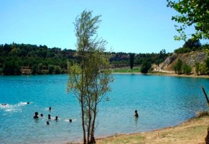 People swimming in a lake on a hot sunny day in the Mediterranean
